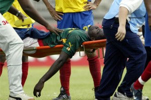 professional soccer player being carried off the field after a heart attack