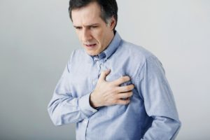 man suffering with chest pains